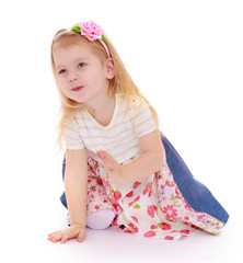 Cute cheerful little girl crawling on the floor