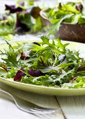 mixture of salad on a wooden background
