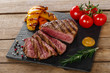 grilled beef steak rare sliced with vegetables - 79833874
