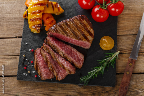 grilled beef steak rare sliced with vegetables Poster