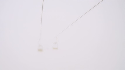 Empty Ski Lift in the Fog