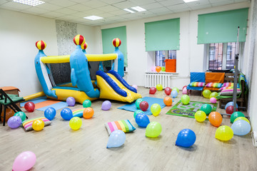 Interior of room, inflatable trampoline, kids birthday or party
