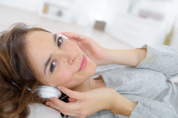Woman relaxing to some music