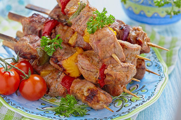 Grilled pork meat and vegetable kebabs