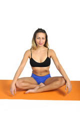 young sexy woman at gym doing yoga mat exercise in relax at gym