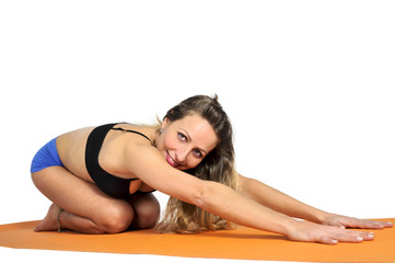 young sexy attractive fit woman at gym doing yoga exercise