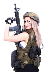 Woman in a military camouflage holding the assault rifle