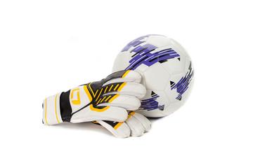 Soccer goalkeeper gloves and a ball on white
