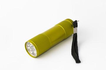 Yellow-green led aluminum flashlight on a white background
