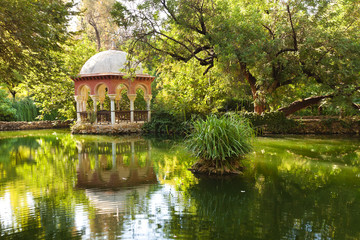 Romantic pavilion reflected in a pond. Sevilla, Spain