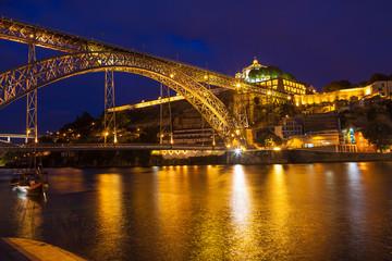 Dom Luis I bridge over Douro river at night. Porto, Portugal
