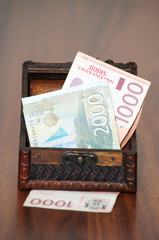 Serbian banknotes in the wooden chest