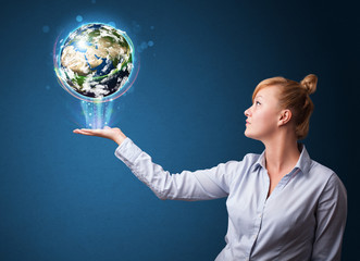 Businesswoman holding glowing earth globe