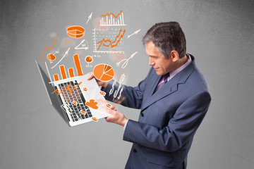 Businessman holding notebook with graphs and statistics