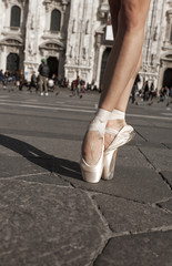 Dancer shoes in the city vertical