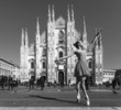 Pretty dancer performing in Milan Cathedral Square black and whi