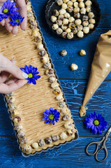 Walnut caramel tart  on a wooden background