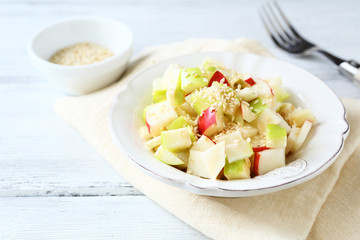 Tasty salad with apples and celery