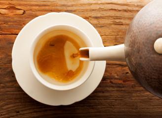 tea pour cup pot wooden table cafe top view