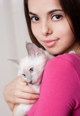 Brunette beauty with cute kitten.