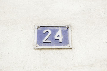 Number twenty four on the wall of a house