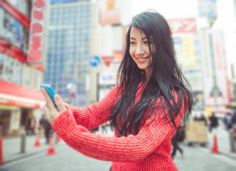 japanese girl taking selfie in tokyo