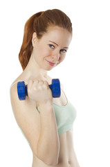 Smiling athletic girl holding a dumbbell on a white background