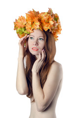 topless redhead girl with a wreath of colorful flowers on her he