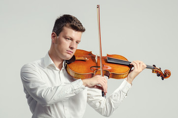 Violinist in white shirt play