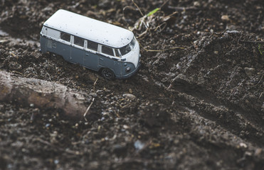 Vintage bus VW. Small metal toy in the nature.