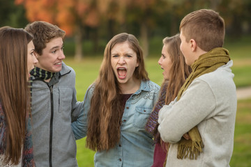 Startled Teens with Yelling Friend