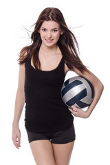 Healthy sporty girl with volleyball