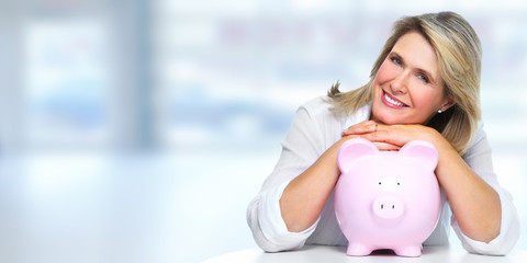 Senior woman with piggy bank.