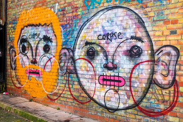Two abstract graffiti faces