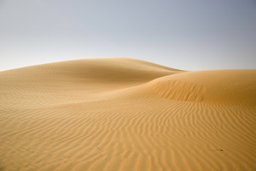 Sand dunes, weaves of dust in a beautiful desert