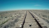 Quad copter shadow in old rustic railroad poster