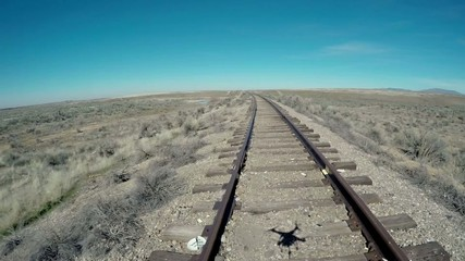 Quad copter shadow in old rustic railroad