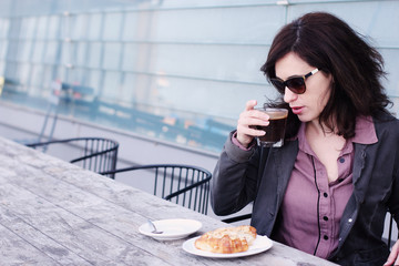 Portrait of the beautiful woman sitting in the cafe