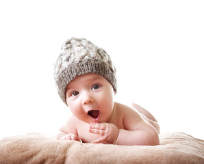 Baby in knitted hat on white background