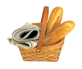 Newspapers and breads in basket