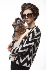 Photo of the girl in the style of fashion  and dog Yorkshire