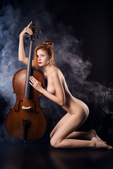 Naked girl playing cello