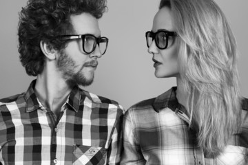 Portrait of gorgeous blond fashion man and woman in casual shir