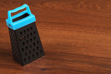 The Mini Grater on the wood
