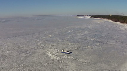 Hovercraft Moves on the Frozen Lake, aerial view