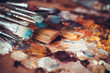 Paintbrushes closeup, artist palette and multicolor paint stains - 79861430