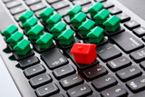 Small toy houses over keyboard