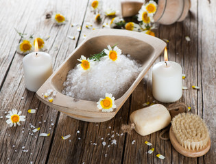Spa composition on wooden plank with chamomile