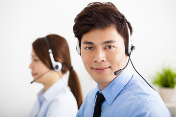 businessman and businesswoman with headset working in office