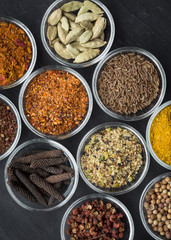 Various spices in small bowls from above